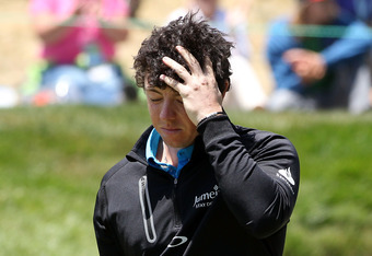 SAN FRANCISCO, CA - JUNE 15:  Rory McIlroy of Northern Ireland walks off the eighth green during the second round of the 112th U.S. Open at The Olympic Club on June 15, 2012 in San Francisco, California.  (Photo by Andrew Redington/Getty Images)