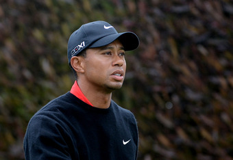 SAN FRANCISCO, CA - JUNE 17:  Tiger Woods of the United States walks off the first tee during the final round of the 112th U.S. Open at The Olympic Club on June 17, 2012 in San Francisco, California.  (Photo by Harry How/Getty Images)