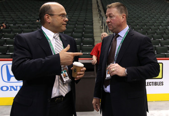 ST PAUL, MN - JUNE 24:  GM's Peter Chiarelli of the Boston Bruins and Mike Gillis of the Vancouver Canucks look on during day one of the 2011 NHL Entry Draft at Xcel Energy Center on June 24, 2011 in St Paul, Minnesota.  (Photo by Bruce Bennett/Getty Imag