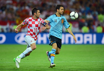 GDANSK, POLAND - JUNE 18:  Cesc Fabregas of Spain and Darijo Srna of Croatia battle for the ball during the UEFA EURO 2012 group C match between Croatia and Spain at The Municipal Stadium on June 18, 2012 in Gdansk, Poland.  (Photo by Shaun Botterill/Gett