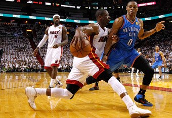 MIAMI, FL - JUNE 17:  Dwyane Wade #3 of the Miami Heat drives in the first hallf against Russell Westbrook #0 of the Oklahoma City Thunder in Game Three of the 2012 NBA Finals on June 17, 2012 at American Airlines Arena in Miami, Florida.  NOTE TO USER: U