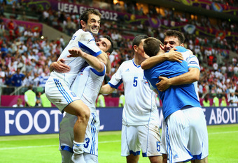 WARSAW, POLAND - JUNE 16:  Giorgos Karagounis (L) of Greece and team mates celebrate victory and progress to the quarter finals during the UEFA EURO 2012 group A match between Greece and Russia at The National Stadium on June 16, 2012 in Warsaw, Poland.