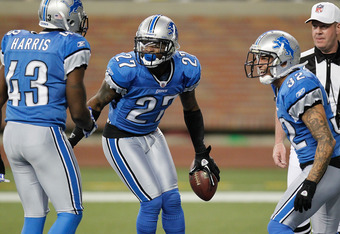 DETROIT, MI - DECEMBER 11:  Alphonso Smith #27 of the Detroit Lions celebrates a touchdown after a second quarter interception while playing the the Minnesota Vikings with Chris Harris #43 and Aaron Berry #32 at Ford Field on December 11, 2011 in Detroit,