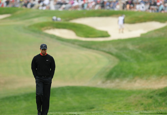 SAN FRANCISCO, CA - JUNE 17: Tiger Woods of the United States walks to the eighth tee during the final round of the 112th U.S. Open at The Olympic Club on June 17, 2012 in San Francisco, California.  (Photo by Stuart Franklin/Getty Images)
