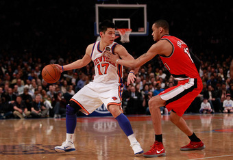NEW YORK, NY - MARCH 14:  (L) Jeremy Lin #17 of the New York Knicks drives against (R) Chris Johnson #17 of the Portland Trail Blazers at Madison Square Garden on March 14, 2012 in New York City. NOTE TO USER: User expressly acknowledges and agrees that,