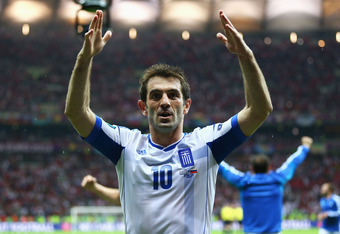 Greek God: Giorgios Karagounis sends Greece through.