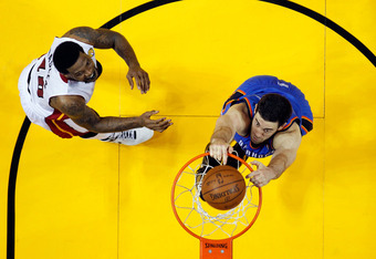 MIAMI, FL - JUNE 17:  Nick Collison #4 of the Oklahoma City Thunder dunks in against Udonis Haslem #40 of the Miami Heat in Game Three of the 2012 NBA Finals on June 17, 2012 at American Airlines Arena in Miami, Florida.  NOTE TO USER: User expressly ackn