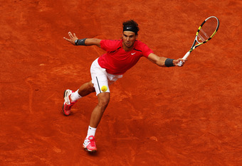 PARIS, FRANCE - JUNE 11:  Rafael Nadal of Spain plays a forehand in the men's singles final against Novak Djokovic of Serbia during day 16 of the French Open at Roland Garros on June 11, 2012 in Paris, France.  (Photo by Clive Brunskill/Getty Images)