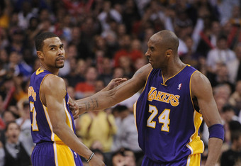 LOS ANGELES, CA - APRIL 04:  Ramon Sessions #7 of the Los Angeles Lakers gets a reaction from Kobe Bryant #24 after his basket in at Staples Center on April 4, 2012 in Los Angeles, California.  NOTE TO USER: User expressly acknowledges and agrees that, by