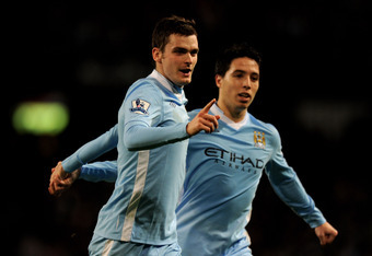 MANCHESTER, ENGLAND - DECEMBER 21:   Adam Johnson of Manchester City celebrates scoring his team's second goal during the Barclays Premier League match between Manchester City and Stoke City at the Etihad Stadium on December 21, 2011 in Manchester, Englan