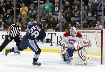PITTSBURGH, PA - JANUARY 20:  Peter Budaj #30 of the Montreal Canadiens makes a save during the shootout against Kris Letang #58 of the Pittsburgh Penguins at Consol Energy Center on January 20, 2011 in Pittsburgh, Pennsylvania.  The Penguins won 5-4 in a