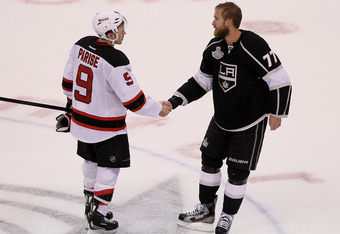 LOS ANGELES, CA - JUNE 11:  Jeff Carter #77 of the Los Angeles Kings and Zach Parise #9 of the New Jersey Devils shake hands at center ice after the Kings defeated the New Jersey Devils 6-1 to win the Stanley Cup final series 4-2 after Game Six of the 201
