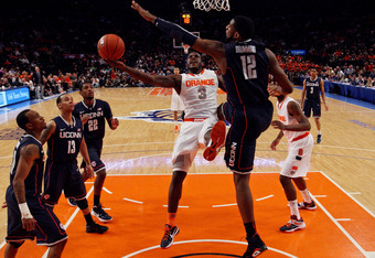 NEW YORK, NY - MARCH 08:  Dion Waiters #3 of the Syracuse Orange goes to the hoop against Andre Drummond #12 of the Connecticut Huskies during the quarterfinals of the Big East Men's Basketball Tournament at Madison Square Garden on March 8, 2012 in New Y