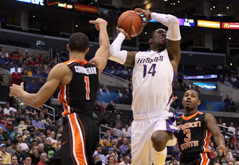LOS ANGELES, CA - MARCH 08:  Tony Wroten #14 of the Washington Huskies goes up for a shot in the lane against Jared Cunningham #1 and Ahmad Starks #3 of the Oregon State Beavers  in the second half during the quarterfinals of the 2012 Pacific Life Pac-12
