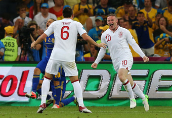 DONETSK, UKRAINE - JUNE 19:  Wayne Rooney of England celebrates scoring their first goal with John Terry of England during the UEFA EURO 2012 group D match between England and Ukraine at Donbass Arena on June 19, 2012 in Donetsk, Ukraine.  (Photo by Marti