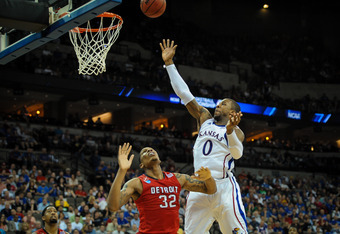 OMAHA, NE - MARCH 16: Thomas Robinson #0 of the Kansas Jayhawks shoots over Eli Holman #32 of the Detroit Titans during the second round of the NCAA Mens Basketball Tournament at CenturyLink Center March 16, 2012 in Omaha, Nebraska. (Photo by Eric Francis
