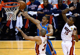 MIAMI, FL - JUNE 17:  Russell Westbrook #0 of the Oklahoma City Thunder drives for a shot attempt in the first half against Shane Battier #31 and Mario Chalmers #15 of the Miami Heat in Game Three of the 2012 NBA Finals on June 17, 2012 at American Airlin