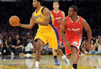 LOS ANGELES, CA - DECEMBER 19:  Darius Morris #1 of the Los Angeles Lakers dribbles as he is pursued by Chris Paul #3 of the Los Angeles Clippers  during the game at Staples Center on December 19, 2011 in Los Angeles, California. NOTE TO USER: User expres