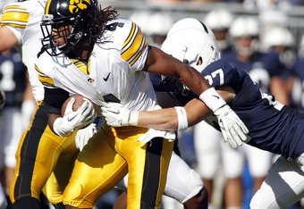 STATE COLLEGE, PA - OCTOBER 8:  Jordan Bernstine #4 of the Iowa Hawkeyes carries the ball on a kickoff return and is tackled by Jacob Fagnano #27 of the Penn State Nittany Lions during the game on October 8, 2011 at Beaver Stadium in State College, Pennsy