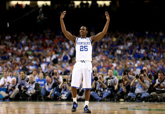 NEW ORLEANS, LA - MARCH 31:  Marquis Teague #25 of the Kentucky Wildcats reacts in the first half against the Louisville Cardinals during the National Semifinal game of the 2012 NCAA Division I Men's Basketball Championship at the Mercedes-Benz Superdome