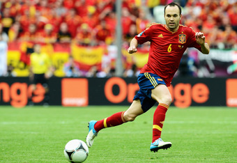 GDANSK, POLAND - JUNE 10:  Andres Iniesta of Spain with the ball during the UEFA EURO 2012 group C match between Spain and Italy at The Municipal Stadium on June 10, 2012 in Gdansk, Poland.  (Photo by Claudio Villa/Getty Images)