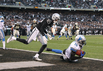 OAKLAND, CA - DECEMBER 18:  Titus Young #16 of the Detroit Lions catches a touchdown in front of DeMarcus Van Dyke #23 of the Oakland Raiders at O.co Coliseum on December 18, 2011 in Oakland, California.  (Photo by Ezra Shaw/Getty Images)