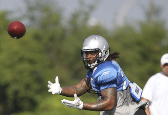 ALLEN PARK, MI - AUGUST 01:  Mikel Leshoure #25 of the Detroit Lions go through the daily practice session at the Lions training facility on August 1, 2011 in Allen Park, Michigan.  (Photo by Leon Halip/Getty Images)