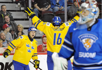 CALGARY, CANADA - JANUARY 3:  William Karlsson #17 of Team Sweden celebrates his second period goal with team mate Filip Forsberg #16 during the 2012 World Junior Hockey Championship Semifinal game against Team Finland at the Saddledome on January 3, 2012