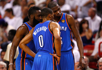 MIAMI, FL - JUNE 19:  (L-R) James Harden #13, Russell Westbrook #0 and Kevin Durant #35 of the Oklahoma City Thunder talk on court against the Miami Heat in Game Four of the 2012 NBA Finals on June 19, 2012 at American Airlines Arena in Miami, Florida. NO