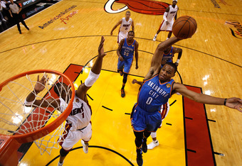 MIAMI, FL - JUNE 19:  Russell Westbrook #0 of the Oklahoma City Thunder misses a dunk attempt in the first half against Chris Bosh #1 of the Miami Heat in Game Four of the 2012 NBA Finals on June 19, 2012 at American Airlines Arena in Miami, Florida. NOTE