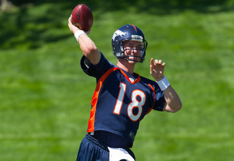 ENGLEWOOD, CO - MAY 21:  Quarterback Peyton Manning #18 of the Denver Broncos throws during organized team activities at Dove Valley on May 21, 2012 in Englewood, Colorado. (Photo by Justin Edmonds/Getty Images)