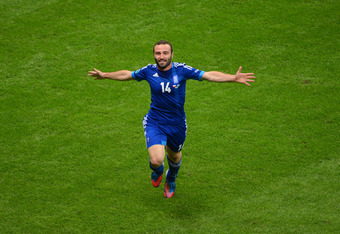 WARSAW, POLAND - JUNE 08:  Dimitris Salpigidis of Greece celebrates scoring their first goal during the UEFA EURO 2012 group A match between Poland and Greece at The National Stadium on June 8, 2012 in Warsaw, Poland.  (Photo by Shaun Botterill/Getty Imag