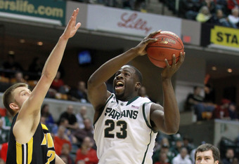 INDIANAPOLIS, IN - MARCH 09:  Draymond Green #23 of the Michigan State Spartans drives for a shot attempt in the first half against the Iowa Hawkeyes during their quarterfinal game of 2012 Big Ten Men's Basketball Conferene Tournament at Bankers Life Fiel