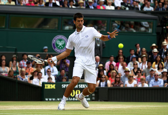 LONDON, ENGLAND - JULY 03:  Novak Djokovic of Serbia returns a shot during his final round Gentlemen's match against Rafael Nadal of Spain on Day Thirteen of the Wimbledon Lawn Tennis Championships at the All England Lawn Tennis and Croquet Club on July 3