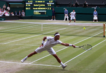 LONDON, ENGLAND - JULY 03:  Rafael Nadal of Spain and Novak Djokovic of Serbia in action on centre court during their final round Gentlemen's match on Day Thirteen of the Wimbledon Lawn Tennis Championships at the All England Lawn Tennis and Croquet Club