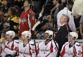 BOSTON, MA - APRIL 14: Head coach Dale Hunter of the Washington Capitals looks on during in Game Two of the Eastern Conference Quarterfinals during the 2012 NHL Stanley Cup Playoffs at TD Garden on April 14, 2012 in Boston, Massachusetts. The Washington C