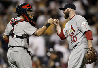 PITTSBURGH, PA - APRIL 20:  Jason Motte #30 of the St Louis Cardinals celebrates with teammate Yadier Molina #4 following their win against the Pittsburgh Pirates during the game on April 20, 2012 at PNC Park in Pittsburgh, Pennsylvania.  (Photo by Jared