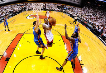 MIAMI, FL - JUNE 19:  Mario Chalmers #15 of the Miami Heat drives for a shot attempt in the second half against Nick Collison #4 and James Harden #13 of the Oklahoma City Thunder in Game Four of the 2012 NBA Finals on June 19, 2012 at American Airlines Ar