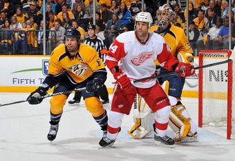NASHVILLE, TN - APRIL 13:  Shea Weber #6 of the Nashville Predators and Todd Bertuzzi #44 of the Detroit Red Wings hold their positions in front of goalie Pekka Rinne #35 in Game Two of the Western Conference Quarterfinals during the 2012 NHL Stanley Cup