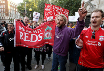 LONDON, ENGLAND - OCTOBER 12:  Supporters of Liverpool Football Club demonstrate outside the High Court on October 12, 2010 in London, England. The Royal Bank of Scotland, which holds the majority of Liverpool's debts, is seeking a high court order to pre