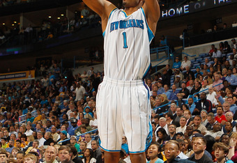 NEW ORLEANS, LA - MARCH 14:  Trevor Ariza #1 of the New Orleans Hornets shoots the ball against the Los Angeles Lakers at the New Orleans Arena on March 14, 2012 in New Orleans, Louisiana.  NOTE TO USER: User expressly acknowledges and agrees that, by dow