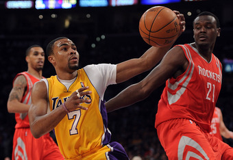 LOS ANGELES, CA - APRIL 06:  Ramon Sessions #7 of the Los Angeles Lakers fakes a pass in front of Samuel Dalembert #21 of the Houston Rockets at Staples Center on April 6, 2012 in Los Angeles, California.  NOTE TO USER: User expressly acknowledges and agr