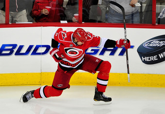 RALEIGH, NC - FEBRUARY 28:  Bryan Allen #5 of the Carolina Hurricanes celebrates after scoring the game-winning goal against the Nashville Predators during the third period at the RBC Center on February 28, 2012 in Raleigh, North Carolina. The Hurricanes
