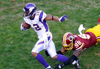LANDOVER, MD - DECEMBER 24:  Percy Harvin #12 of the Minnesota Vikings breaks a tackle by Brian Orakpo #98 of the Washington Redskins during the first quarter at FedExField on December 24, 2011 in Landover, Maryland.  (Photo by Patrick McDermott/Getty Ima
