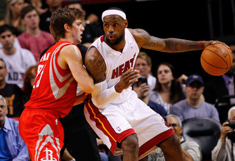 MIAMI, FL - APRIL 22:  LeBron James #6 of the Miami Heat posts up Chandler Parsons #25 of the Houston Rockets during a game  at American Airlines Arena on April 22, 2012 in Miami, Florida. NOTE TO USER: User expressly acknowledges and agrees that, by down