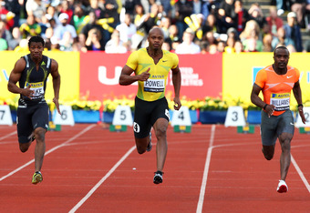 LONDON, ENGLAND - JULY 24:  (L to R) Yohan Blake of Jamaica, Asafa Powell of Jamaica and Ivory Williams of USA compete in the Men's 100m Heat during day one of the Aviva London Grand Prix track and field meeting at Crystal Palace Stadium on July 24, 2009