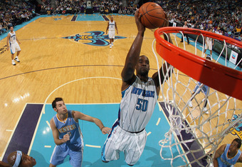 NEW ORLEANS, LA - JANUARY 06:  Emeka Okafor #50 of the New Orleans Hornets dunks the ball during the game against the Denver Nuggets at the New Orleans Arena on January 6, 2012 in New Orleans, Louisiana.  NOTE TO USER: User expressly acknowledges and agre