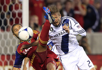 SANDY, UT - JUNE 20: Alvaro Saborio #15  of Real Salt Lake takes a shot on goal past David Beckham #23 of Los Angeles Galaxy during the second half of an MLS soccer game June 20, 2012 at Rio Tinto Stadium in Sandy, Utah. Los Angeles Galaxy beat Real Salt