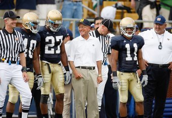 SOUTH BEND,IN - SEPTEMBER 13:  Former head coach Lou Holtz of the Notre Dame Fighting Irish stands with players before the game against the Michigan Wolverines on September 13, 2008 at Notre Dame Stadium in South Bend, Indiana. (Photo by: Gregory Shamus/G