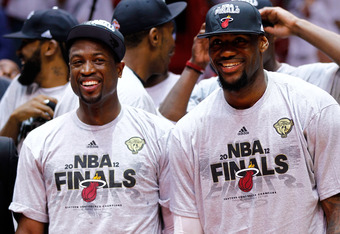 MIAMI, FL - JUNE 09:  Dwyane Wade and LeBron James #6 of the Miami Heat celebrate after the Heat defeat the Boston Celtics 101-88 and adcance to the NBA Finals in Game Seven of the Eastern Conference Finals in the 2012 NBA Playoffs on June 9, 2012 at Amer